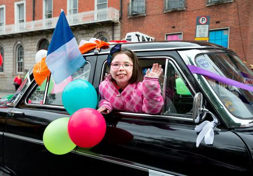 Sharon Gobbett, 10, from St Joseph's Special School Tallaght waves from a vintage taxi on Parnell Square during the Special Children's Taxi Day out. Photo: Tony Gavin 13//9/2016