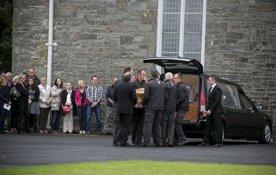 The remains of Caitríona Lucas are brought to the church in Liscannor, County Clare by her colleagues in Doolin search and rescue Pic: Mark Condren