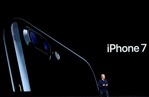 Apple ceo Tim Cook launches the company's latest phone, but is it worth the upgrade. Photographer: David Paul Morris/Bloomberg