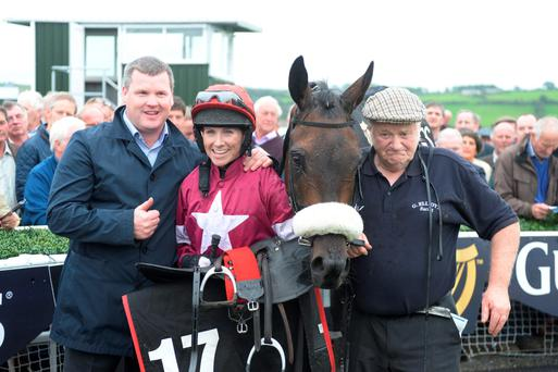 Jockey Lisa O'Neill and trainer Gordon Elliott with Wrath Of Titans after winning the Guinness Kerry National at Listowel Races Don MacMonagle. Photo: Don MacMonagle