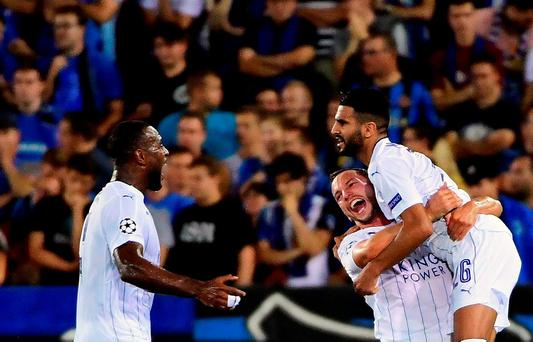 Leicester City's Riyad Mahrez (R) celebrates with teammates