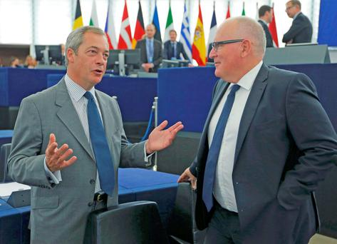 Nigel Farage, United Kingdom Independence Party (UKIP) member and MEP talks with European Commission First Vice-President Frans Timmermans ahead of a debate on The State of the European Union at the European Parliament in Strasbourg, France, September 14, 2016 Picture: REUTERS/Vincent Kessler
