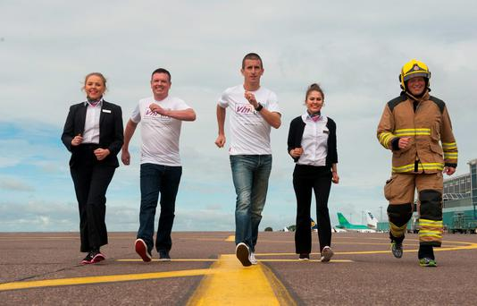 From left: Orla Burke, The Loop at Cork Airport; Lust for Life co-founder Derry McVeigh; Olympic hero Rob Heffernan; Holly Conroy, The Loop; and Fergal Sargent of the Cork Airport Fire Police Picture: RD Photo
