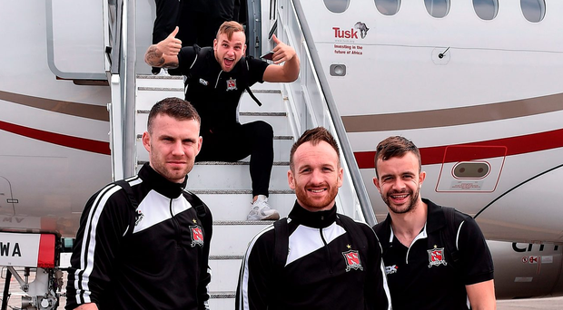 Paddy Barrett makes his presence felt behind fellow Dundalk players Ciaran Kilduff, Stephen O'Donnell and Robbie Benson at Dublin Airport. Photo by David Maher/Sportsfile