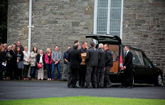 The remains of Caitriona Lucas are brought to the church in Liscannor, Co Clare, by her colleagues in Doolin Search and Rescue Photo: Mark Condren