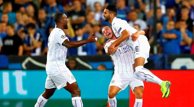 Riyad Mahrez of Leicester City celebrates with team-mates Wes Morgan and Danny Drinkwater. Photo: Dean Mouhtaropoulos/Getty Images