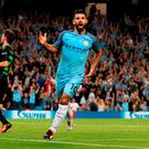 Manchester City's Sergio Aguero celebrates scoring his hat-trick. Photo: Martin Rickett/PA Wire