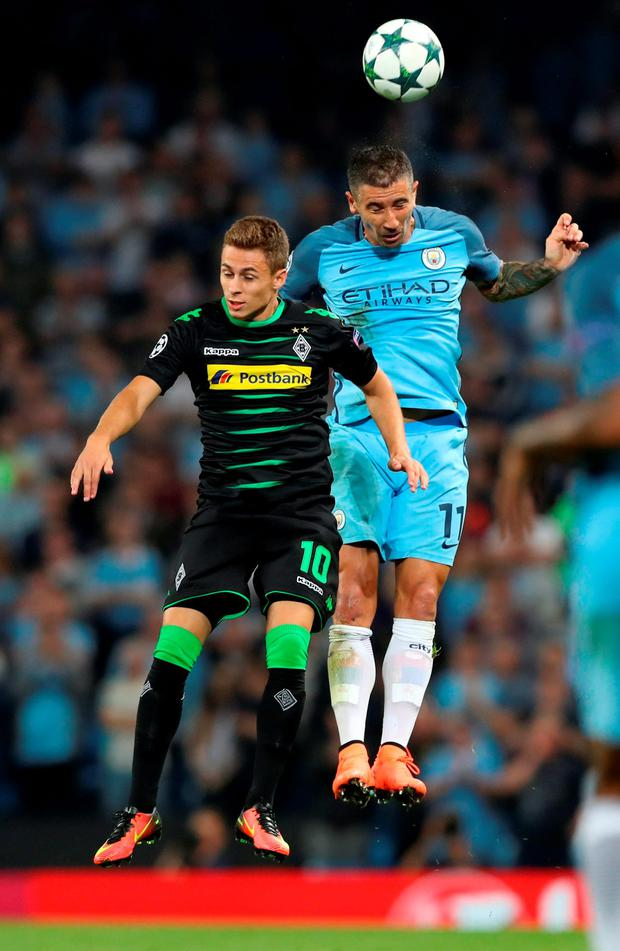 Manchester City's Aleksandar Kolarov and Borussia Monchengladbach's Thorgan Hazard. Photo: Martin Rickett/PA Wire