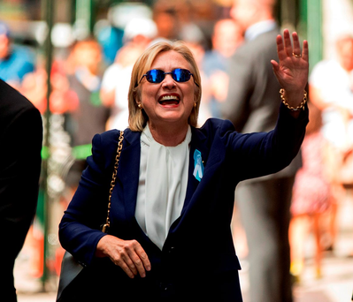 Clinton was seen on Sunday reassuring the press after her collapse that day. Photo: AP