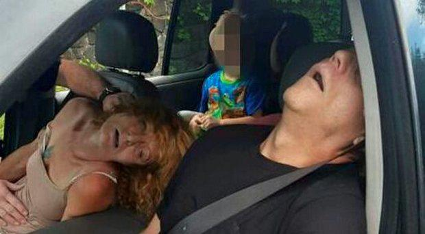 The boy photographed in the car with his parents