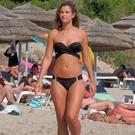 Vogue Williams hits the beach in a black bikini in Ayia Napa. Picture: Splash News