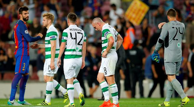 Celtic's players leave the pitch at the end of a thrashing against Barca