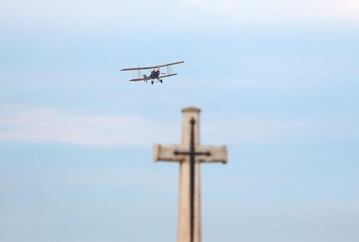 A replica World War One plane flies over the Caterpillar Valley Commonwealth War Graves Commission Cemetery in Longueval, France Credit: Gareth Fuller/PA Wire