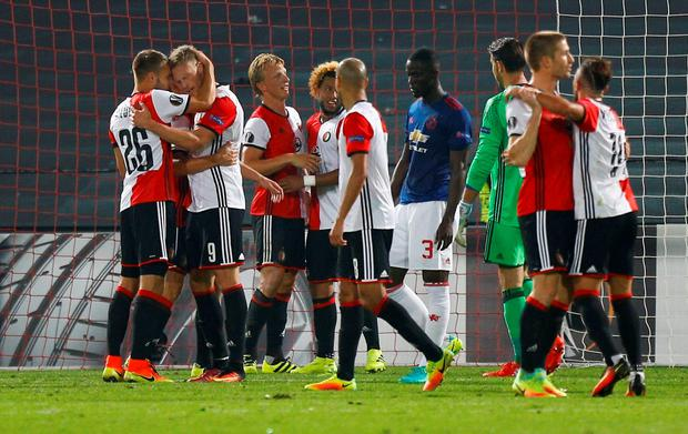 Manchester United's Eric Bailly looks dejected as Feyenoord players celebrate at the end of the match