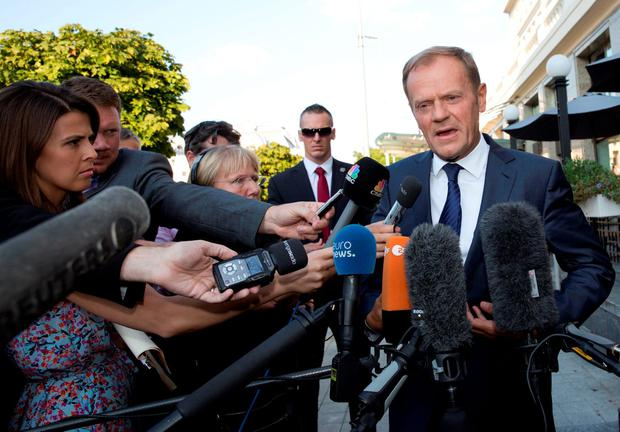 European Council President Donald Tusk speaks with the media outside a hotel prior to an EU summit in Bratislava on Thursday. (AP Photo/Virginia Mayo)