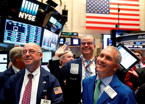 Traders react while working on the floor of the New York Stock Exchange (NYSE) in New York City