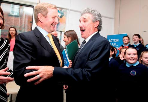 Taoiseach Enda Kenny and Junior Minister John Halligan at St Brigid's National School in The Coombe, Dublin. Photo: Tom Burke