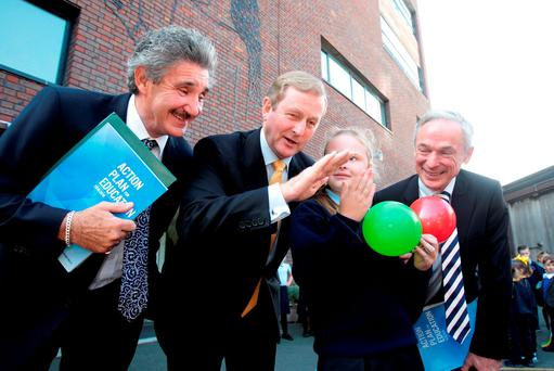 Taoiseach Enda Kenny, Education Minister Richard Bruton, and Training and Skills Minister John Halligan, with 5th.class pupil Katie Quinn on their arrival at St.Brigid's National School,The Coombe ,Dublin for the launch of the Government's Action Plan for Education. Pic Tom Burke