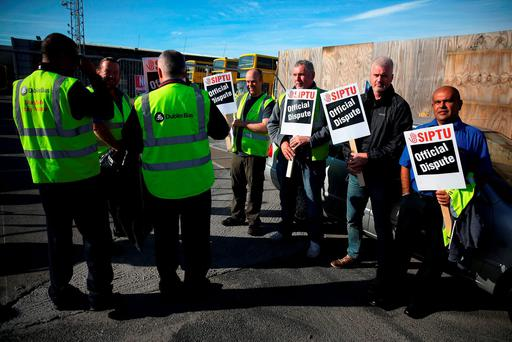Dublin Bus workers on the picket line at the Broadstone depot in Dublin. Photo: Brian Lawless/PA Wire