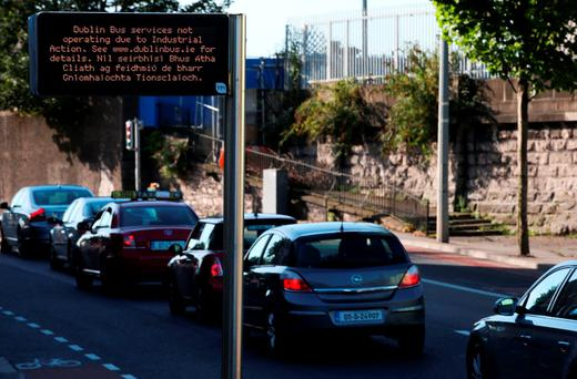 A bus stop sign notifies commuters of industrial action. Photo: Brian Lawless/PA Wire