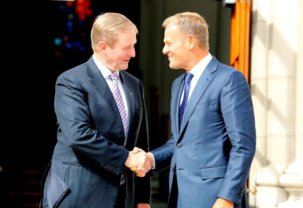Taoiseach Enda Kenny greets Donald Tusk , the President of the European Council, on his arrival for a working lunch at Government Buildings. Pic Tom Burke