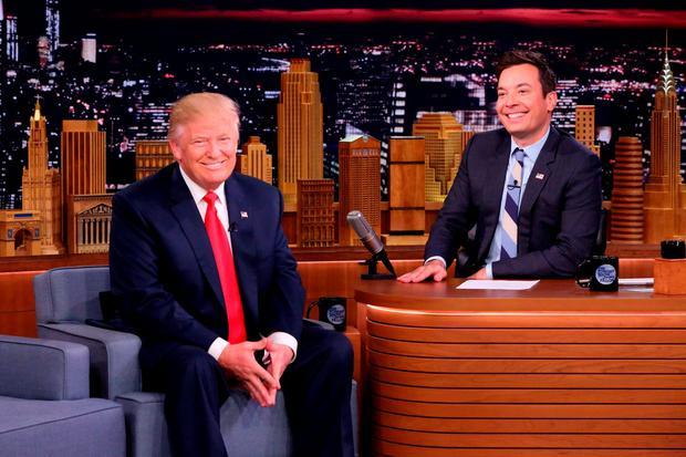 In this image released by NBC, Republican presidential candidate Donald Trump appears with host Jimmy Fallon during a taping of