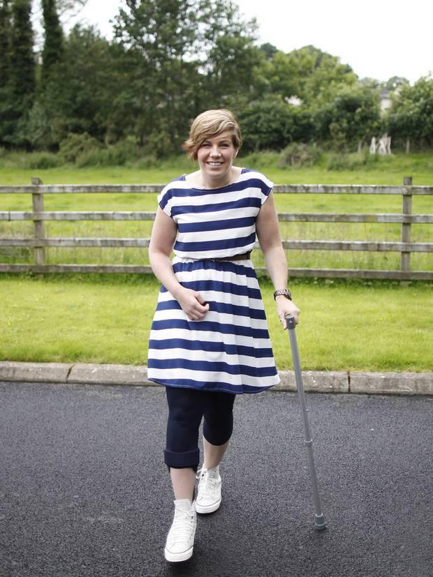 Clodagh walking with the aid of a crutch during her recovery