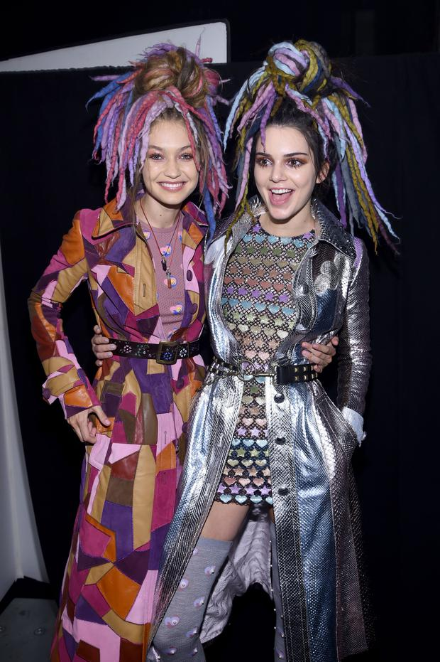 Gigi Hadid and Kendall Jenner pose backstage at the Marc Jacobs Spring 2017 fashion show during New York Fashion Week. (Photo by Dimitrios Kambouris/Getty Images for Marc Jacobs)