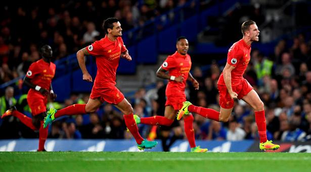 Britain Football Soccer - Chelsea v Liverpool - Premier League - Stamford Bridge - 16/9/16 Liverpool's Jordan Henderson celebrates scoring their second goal Reuters / Dylan Martinez Livepic EDITORIAL USE ONLY. No use with unauthorized audio, video, data, fixture lists, club/league logos or