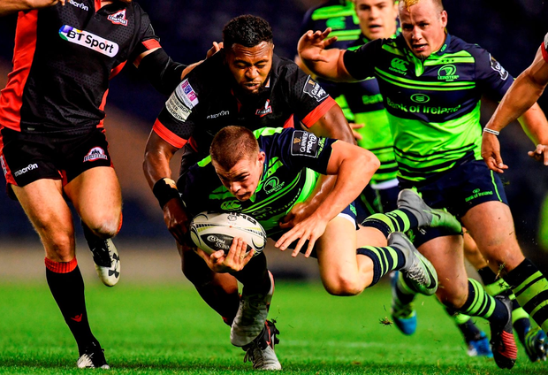 Leinster's Garry Ringrose is tackled by Solomoni Rasolea. Photo by Ramsey Cardy/Sportsfile