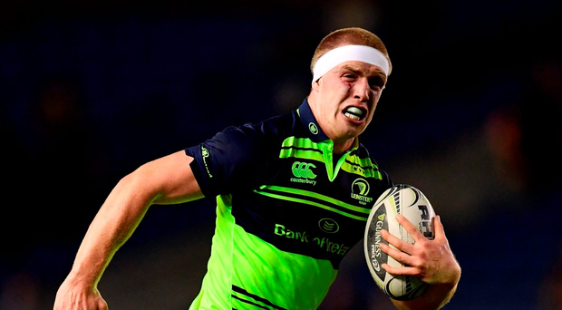 Dan Leavy of Leinster on his way to scoring his first try. Photo by Ramsey Cardy/Sportsfile
