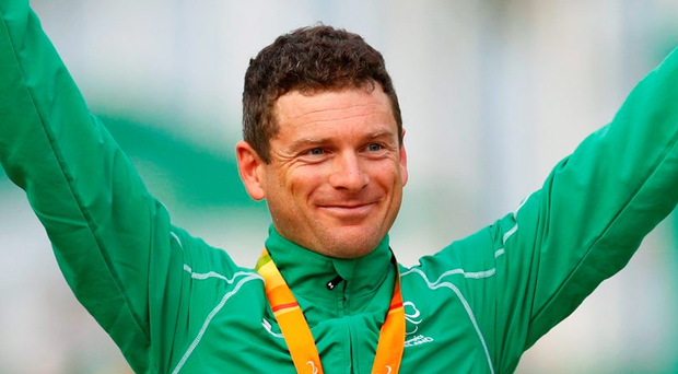 Gold medalist Eoghan Clifford of Ireland poses with his medal. Photo: Reuters