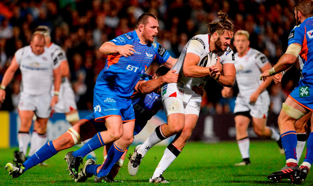 Ulster's Stuart McCloskey of is tackled by Ken Owens. Photo by Oliver McVeigh/Sportsfile