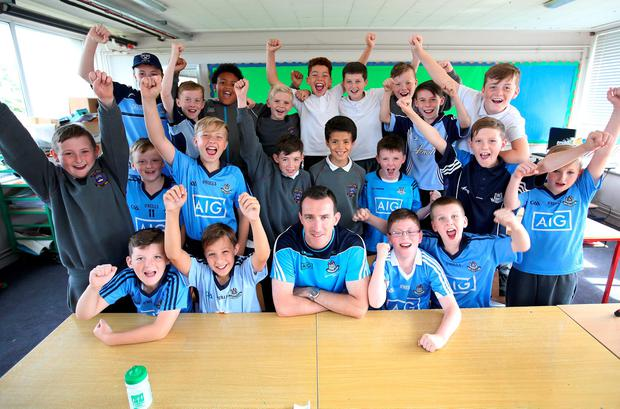Former Dublin footballer Paddy Christie with pupils at Our Lady of Victory Boys National School Photo: Frank McGrath
