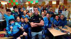 Former Mayo footballer James Burke with his students at Scoil Mhuire in Howth Picture: Caroline Quinn