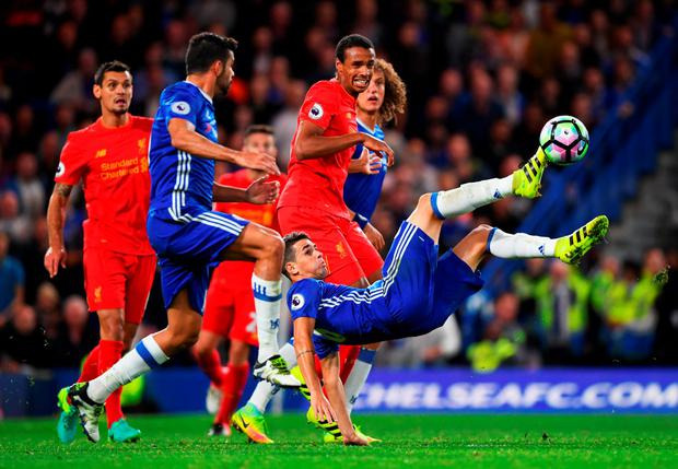 Oscar of Chelsea makes a spectacular attempt to reach the ball. Photo: Getty
