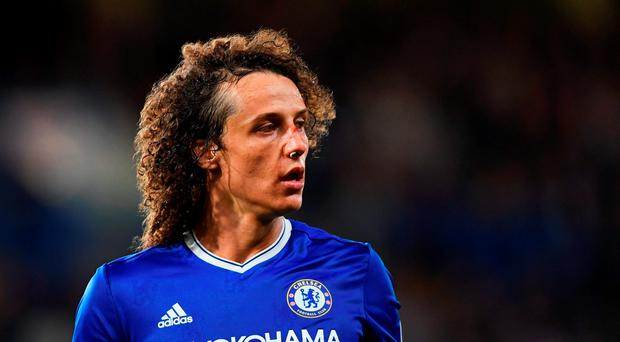 A bloody David Luiz of Chelsea looks on during the Premier League match between Chelsea and Liverpool. Photo: Getty