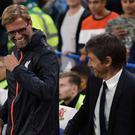Jurgen Klopp and Antonio Conte share a joke on the side-lines. Getty