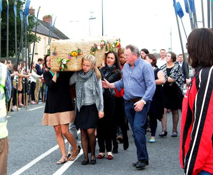 The wicker coffin bearing the remains of Ailish Sheehan is carried by friends for funeral mass in St. Josheph's Church Kildimo, Co Limerick. Photograph: Press 22