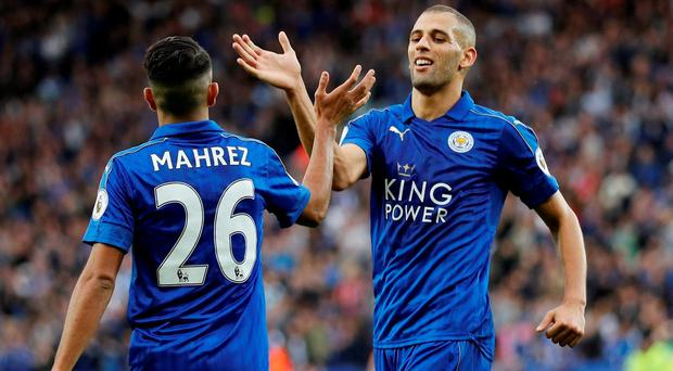 Leicester City's Riyad Mahrez and Islam Slimani celebrate