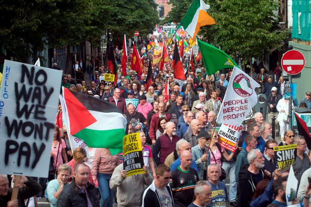 Demonstrators march along Parliament Street during the Anti Water charges protest in Dublin. Photo: Tony Gavin