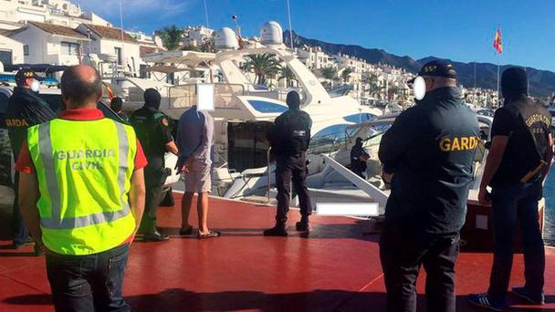 International raid: A yacht is searched on the Costa del Sol last week in a joint operation between Spanish police and garda where one Irishman was arrested in relation to the murder of Gary Hutch last September