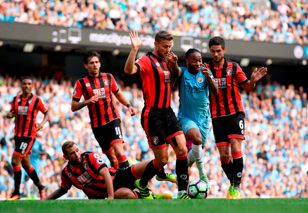 Raheem Sterling bursts through the Bournemouth defence. Photo: Getty