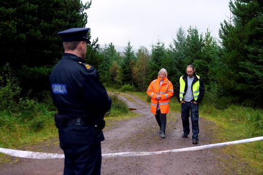 Penny and Crohan Pickard at the site where gardai and Army teams are looking for the body of Charles Brooke Pickard. Photo: Don MacMonagle