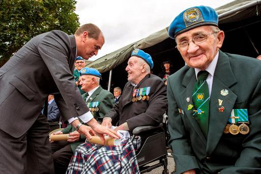 Bravery awards: Minister Kehoe gives a citation to Regimental Sgt. Harry Dixon as Pte. Jimmy Taheny from Sligo waits in line. Photo: Douglas O'Connor
