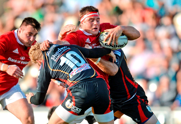 Munster's CJ Stander is tackled by Angus O'Brien. Photo: Sportsfile