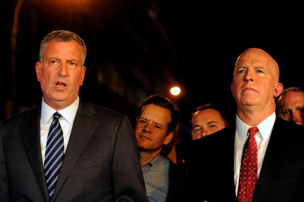New York City Mayor Bill de Blasio (L) and New York Police Department Commissioner James O'Neill give a news conference near the site of an explosion in the Chelsea neighborhood of Manhattan, New York, U.S. September 17, 2016. REUTERS/Stephanie Keith