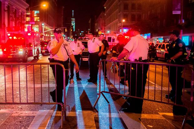 Police work near the scene of an explosion in Manhattan's Chelsea neighborhood, in New York, Saturday, Sept. 17, 2016. (AP Photo/Andres Kudacki)