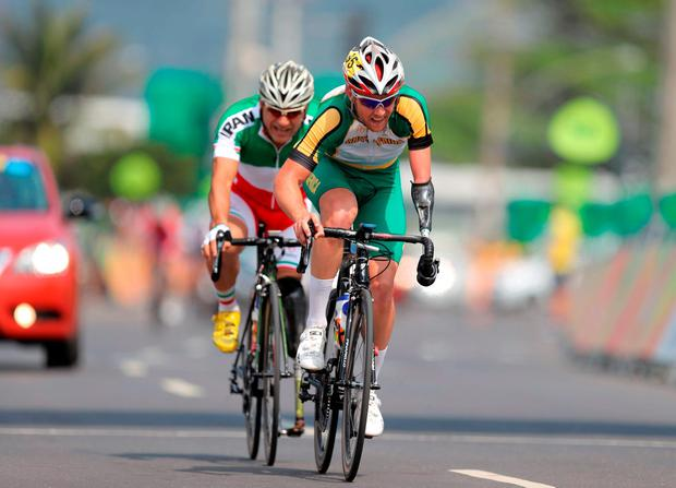 South Africa's Dane Wilson (right) ahead of Iran's Bahman Golbarnezhad as they compete in the Men's Road Race C4-5 during the tenth day of the 2016 Rio Paralympic Games in Rio de Janeiro, Brazil. Andrew Matthews/PA Wire.