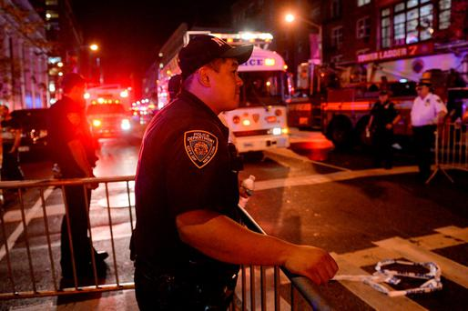 A New York City Police Department (NYPD) officer stands guard near the site of an explosion in the Chelsea neighborhood of Manhattan, New York, U.S. September 18, 2016. REUTERS/Rashid Umar Abbasi
